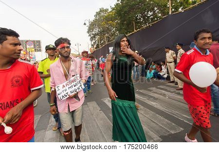 PANAJI, INDIA - FEB 25, 2017: Jealous travesty wife and her husband walking in parade of actors during the traditional carnival in Goa on February 25, 2017. Carnaval is celebrated in Goa since 18th century