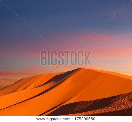 Sand dunes in Sahara desert at sunset in Morocco, Africa