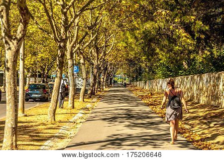 Lisbon, Portugal - Septmember 19, 2016: Young tourists walking Boulevard from Carcavelos station to the beach