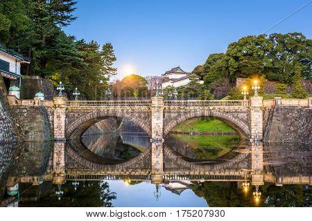 Tokyo, Japan at the Imperial Palace moat and bridge at night.