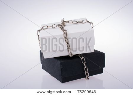 White And Black Gift Boxes With Chains
