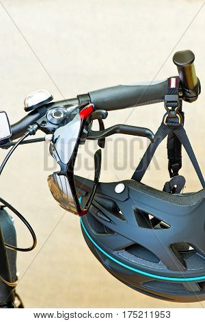 Detail Of Handlebars With Sunglasses And Safety Helmet