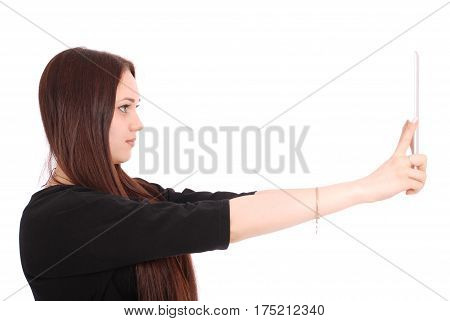 Girl looking at tablet pc standing sideways isolated on white