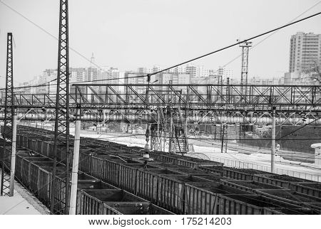 Intermediate station of freight trains and bridge across the railway in black and white version