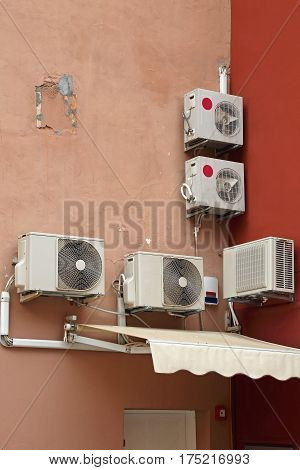 External Compressor Units of Air Conditioners at Building Wall