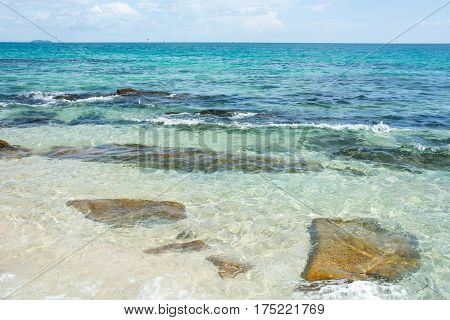 Sandy Beach With Rocks And Crystal Clear Water