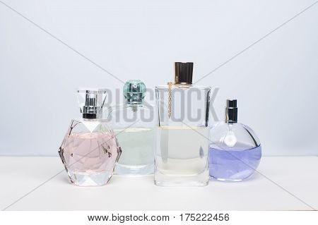 Different perfume bottles on white background. Perfumery, cosmetics