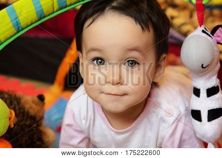 Close up portrait of joyful baby kid in nursery room