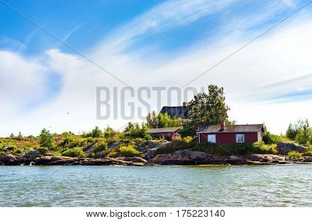 Scandinavian island architecture in Helsinki Finland. Old wooden houses in North style stand on stony shore of island Ryssansaari. Suomi Helsingfors South Gulf