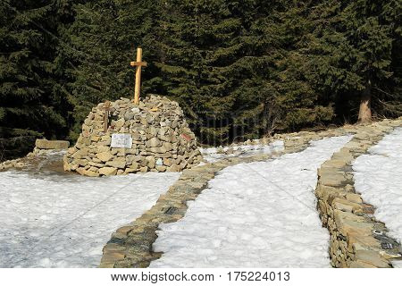 cairn and stone walls on Ivancena built for a memory of scouts murdered during the world war II, Beskydy mountains, Czech Republic