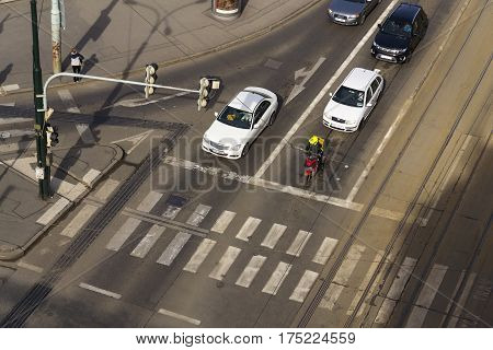 PRAGUE CZECH REPUBLIC - MARCH 3: Bird's eye view of cars and motorbike messenger crossing intersection on March 3 2017 in Prague Czech republic. Volkswagen unveils electric self-driving van on Geneva Motor Show.
