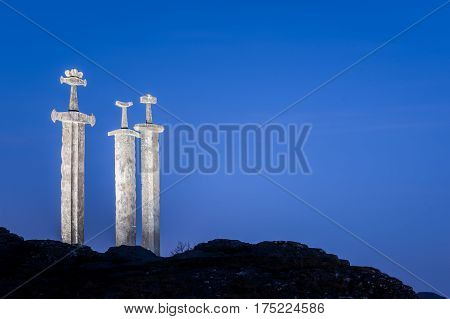 The sculpture of Swords in Rock Sverd i fjell in the Hafrsfjord near Stavanger in Rogaland county, Norway
