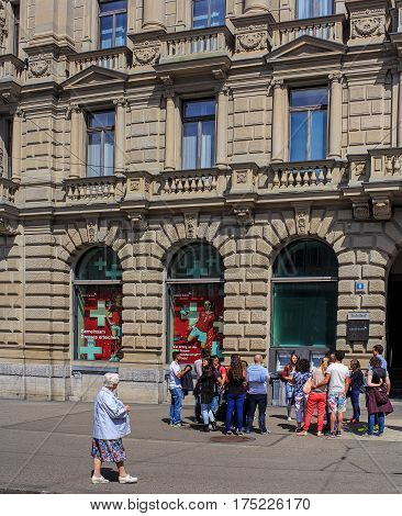 Zurich, Switzerland - 14 May, 2015: a group of people at the Credit Suisse building on Paradeplatz square. Credit Suisse Group is a leading global financial services company headquartered in Zurich.