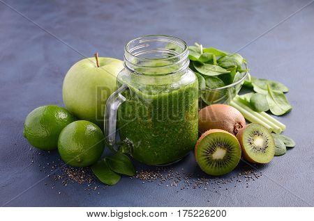Healthy green smoothie with kiwi, apple, spinach and chia seeds.