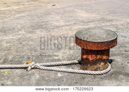 Concrete steel pillar with rope for parking boat