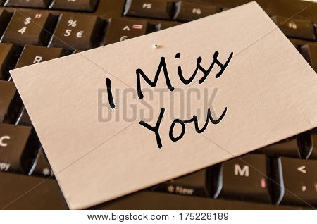 I miss you text concept over dark computer keyboard background