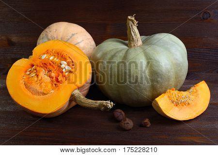 The fresh pumpkin on wooden background background