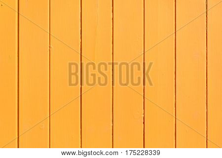 Orange painted wooden wall useful as background