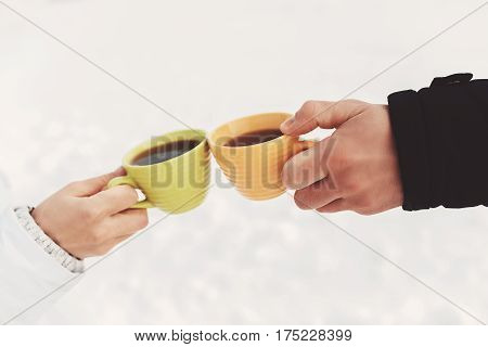 Guy and girl have a good time, drink coffee during the winter holidays. concept of vivacity and health