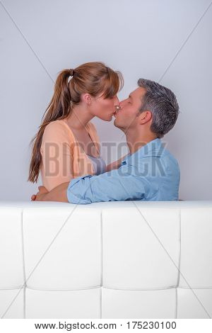kissing couple relaxing in new home