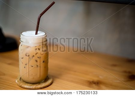 delicious ice coffee capuchino in glass on table