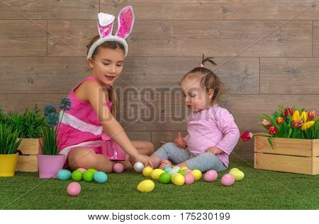 easter childs playing with eggs