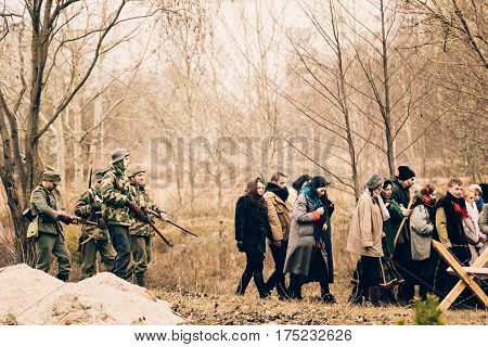 Gomel, Belarus - November 26, 2017: German escort leads civilians to work