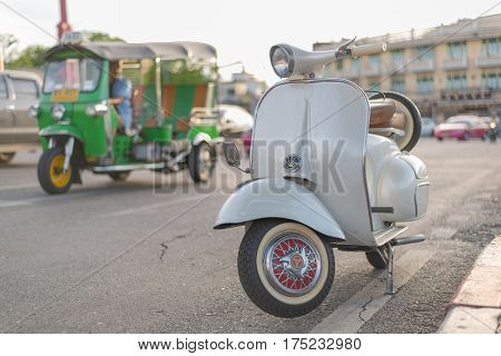 BangkokThailand - July 30 2016 : vintage vespa scooter motorcycle parked with tuktuk background tuk-tuk famous popular vehicle for traveller in bangkok thailand