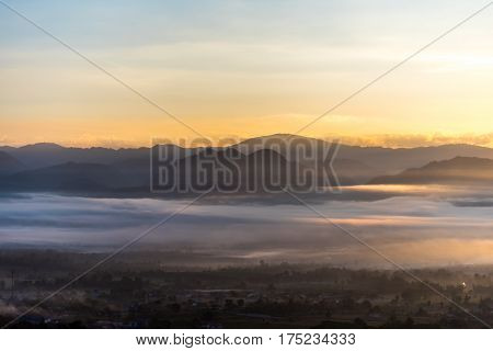 Panorama Of Mountain  With Sun And Fog