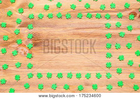 St Patrick's Day. St Patrick's Day background - green lucky quatrefoils on the wooden background with space for text. St Patrick's Day background with St Patrick's Day symbols. St Patrick's Day concept.