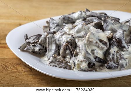 Romanian food - mushrooms with sour cream on plate