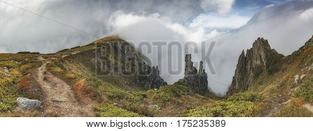 Carpathian Valley With Low Clouds On A Hills