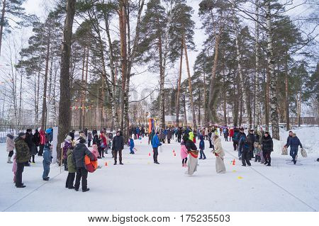 Kostroma Russia February 16 2017: Kids celebrate Maslenitsa Pancake week - purely Russian Holiday. People eat pancakes play folk games have fun letting long winter out Moscow February 16 2016.