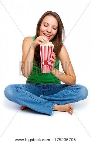 Beautiful isolated girl eating popcorn