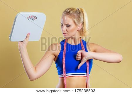 Sad Woman With Weight Gain Thumb Down Sign
