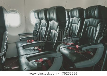 Airplane seats in the cabin ( Filtered image processed vintage effect. )