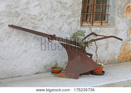 Rusty Old Plow With Big Knife Left On The Farm