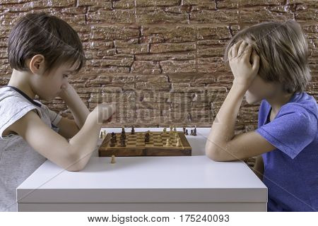 Kids playing a game of chess. Game, education, lifestyle concept