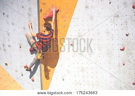 The Girl Climbs On The Climbing Wall.