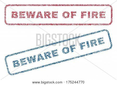 Beware Of Fire text textile seal stamp watermarks. Blue, red fabric vectorized texture. Vector tag inside rounded rectangular shape. Rubber emblem with fiber textile structure.