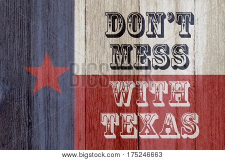 A rustic old Texas message Texas flag on weathered wood background with text Don't mess with Texas 3D Illustration