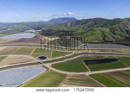 Aerial view of farm fields and Santa Monica Mountains National Recreation Area in Ventura County, California.