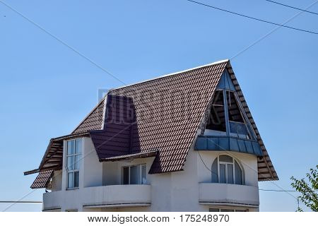 Detached House With A Roof Made Of Steel Sheets.
