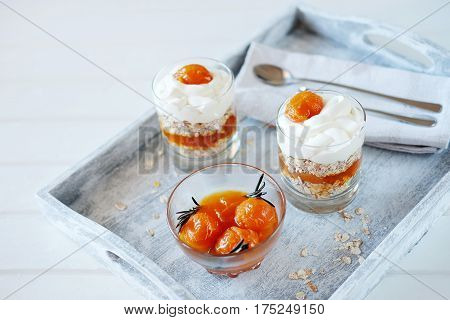 Oats layered with spicy apricot jam and cream