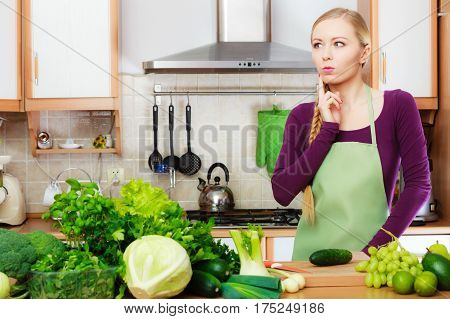 Woman Housewife In Kitchen With Green Vegetables