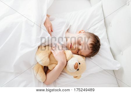 Little Boy Child Sleeping In Bed