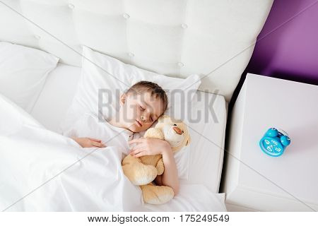 Little Boy Child Sleeping In Bed