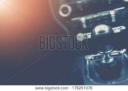 Driving and Cars Background Concept with Copy Space. Modern Car Interior with Manual Transmission Stick Shift.