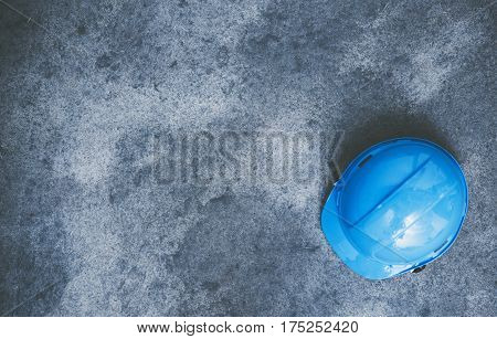 Construction Helmet Hard Hat on the Raw Concrete Floor. Construction Safety Concept Photo with Copy Space. Home Improvement Theme.