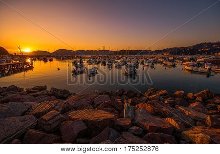 Italian Riviera Marina at Sunset. Lerici italy. Boats and Yachts in the City Marina.